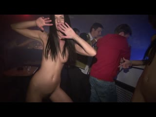Two girls rave naked in a crowded club