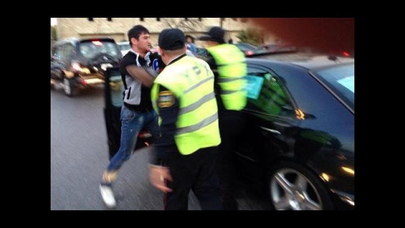Yol polisi və sürücü arasında dava.