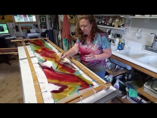 Hand painting a silk scarf