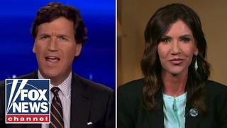 Tucker Carlson presses Kristi Noem on why she vetoed transgender sports bill